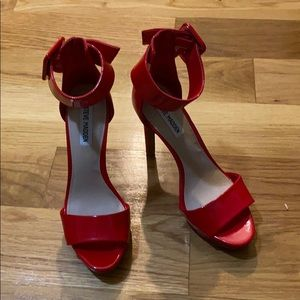 Red high heels, never worn